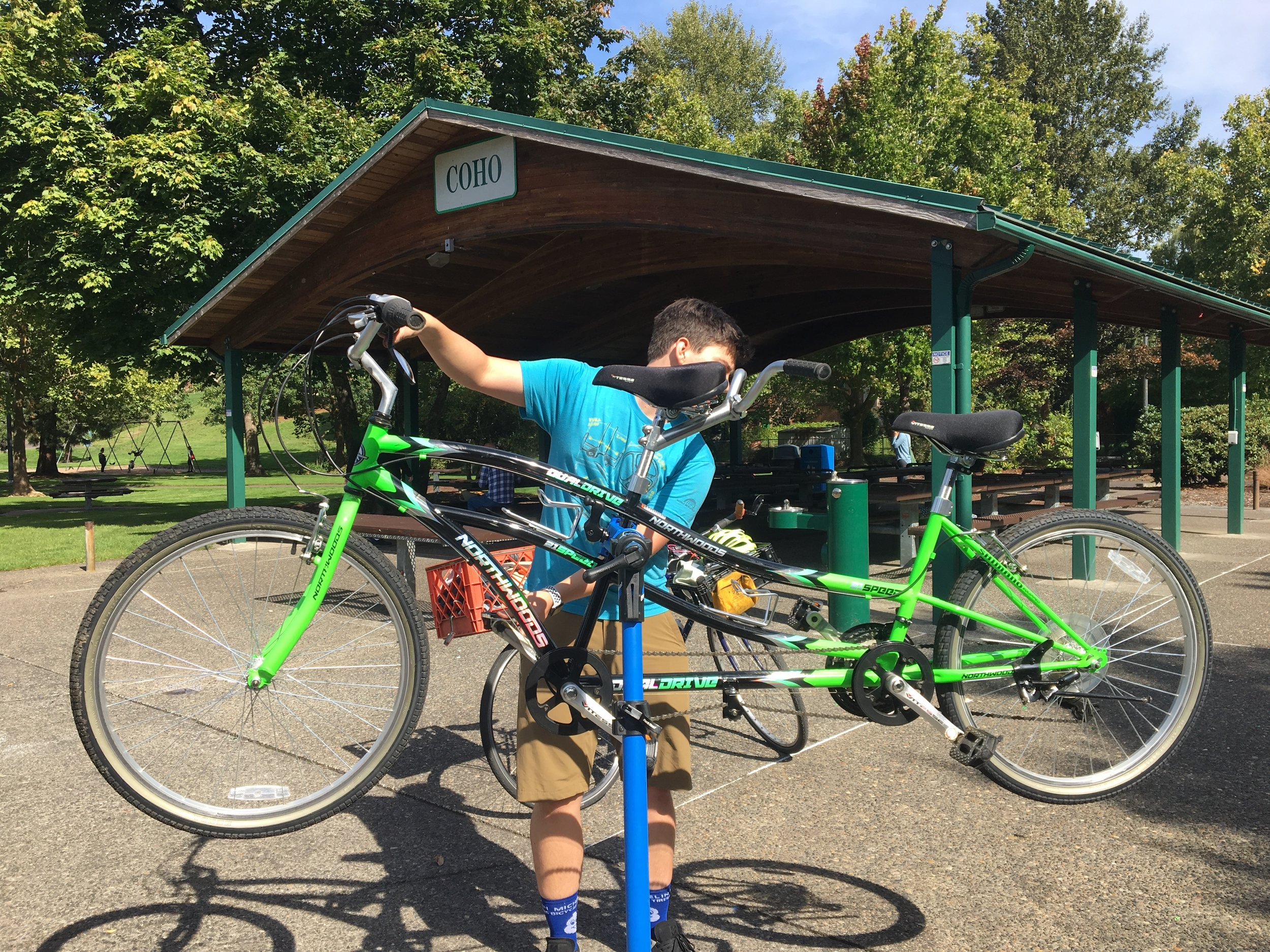 Greg, a B4H staffer, demonstrating the capacity of our mobile repair stand on a tandem bike.
