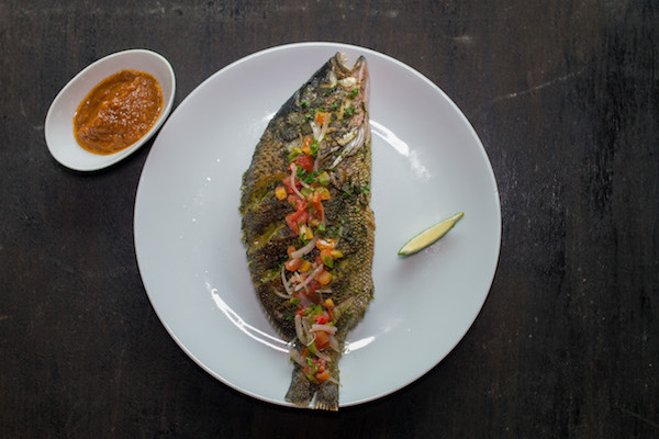 Grilled carp or bar fish - Charcoal-grilled whole Carp or Bar fish, marinated in traditional Douala spices