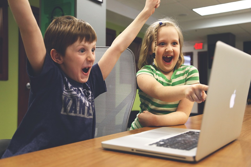 Kids excited at a laptop.jpg