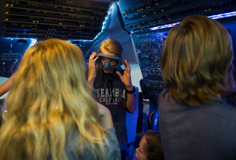 STEM Lab School eighth grade student Lincoln Baldwin, 13, explores a McDonnell Douglass DC-10 cockpit while wearing goggles during an open house to launch a first-ever Drone Project Friday, Sept. 7, 2018 at Wings Over the Rockies Air & Space Museum.