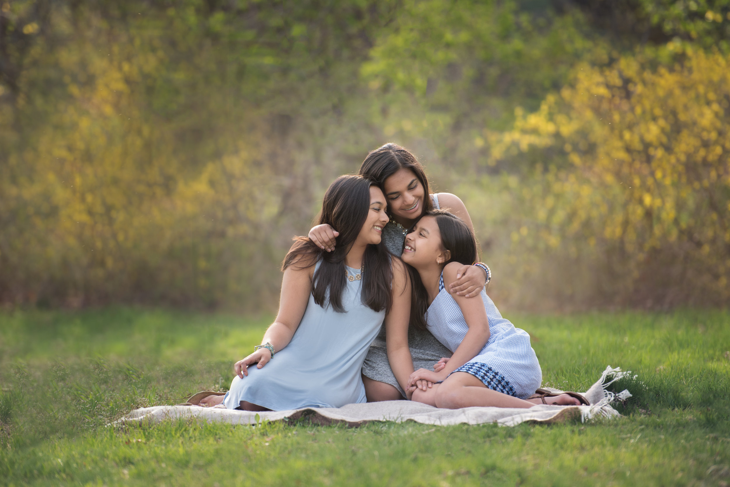 Three Sisters Cuddled Together