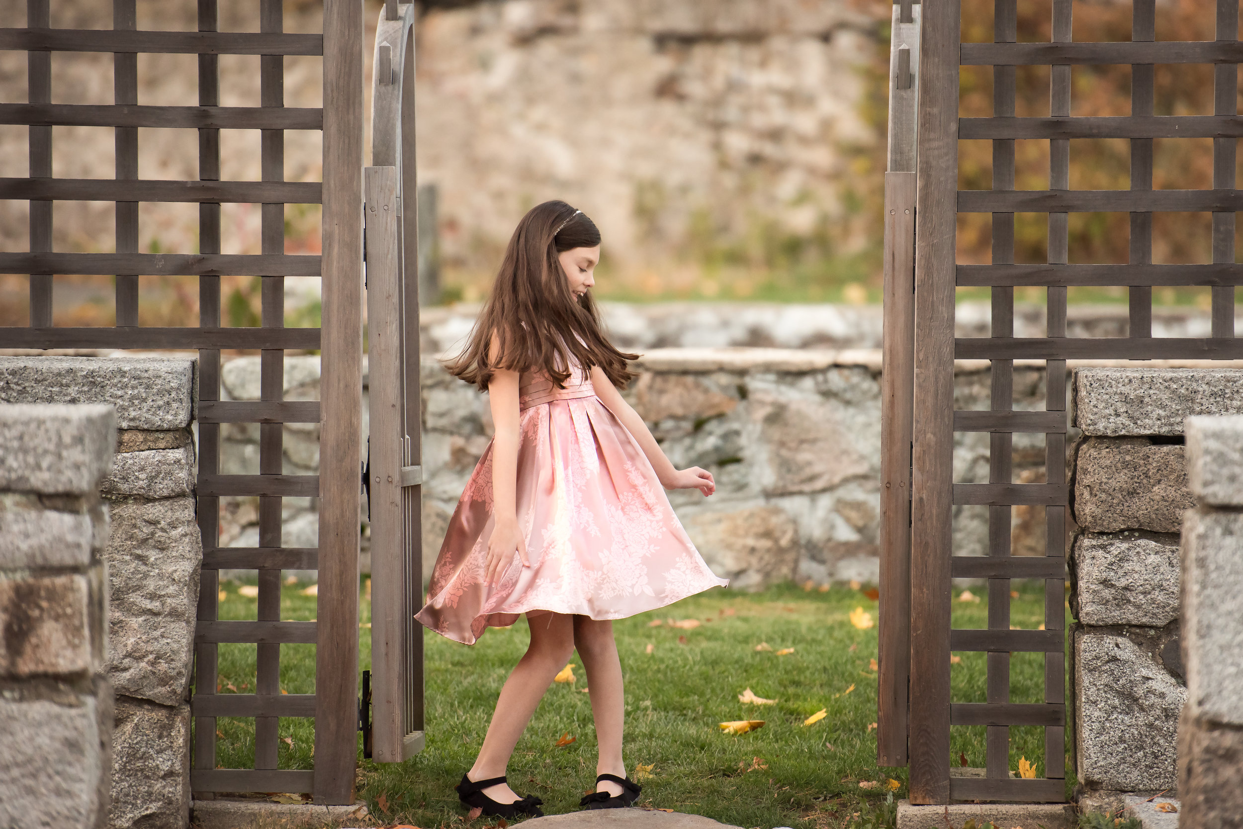 Girl Twirling at Outdoor Gate