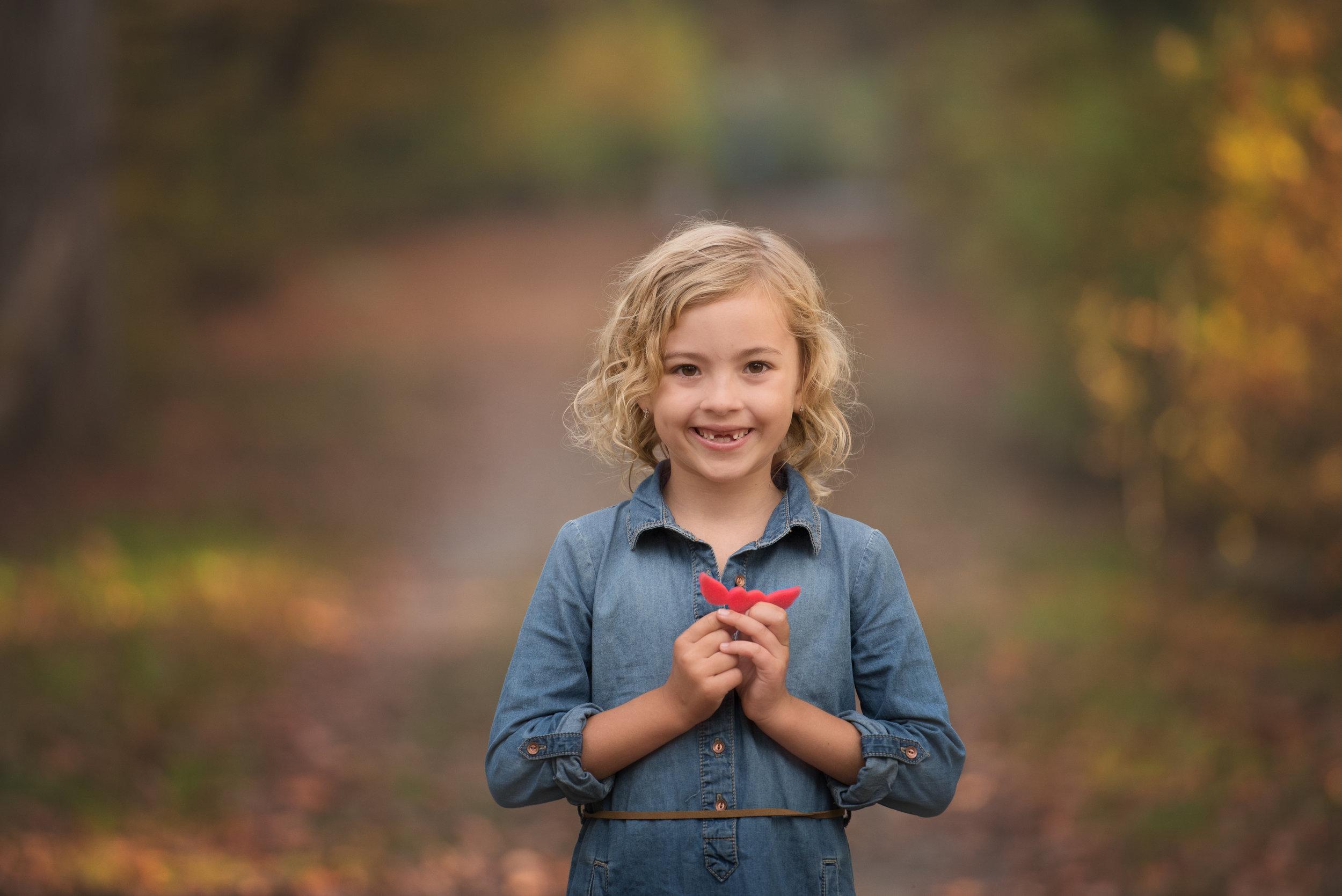 Little Girl Holding Angel Wings