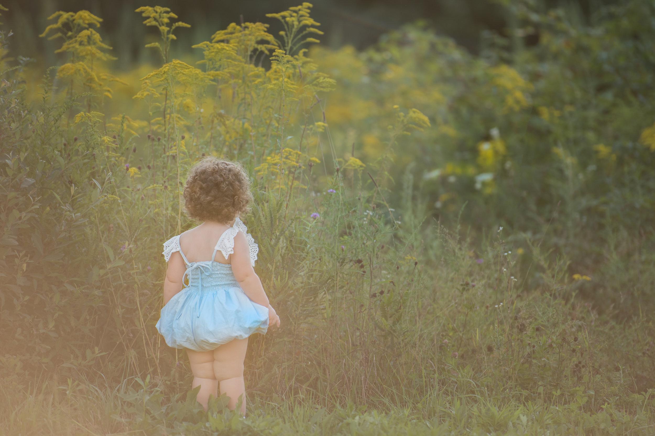 Baby in Blue Dollcake Romper in Wild Field