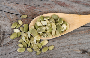 Roughly 120 calories   Tip: Buy raw seeds and add them to a frying pan on medium heat. Stirring occasionally, roast until you hear them pop.