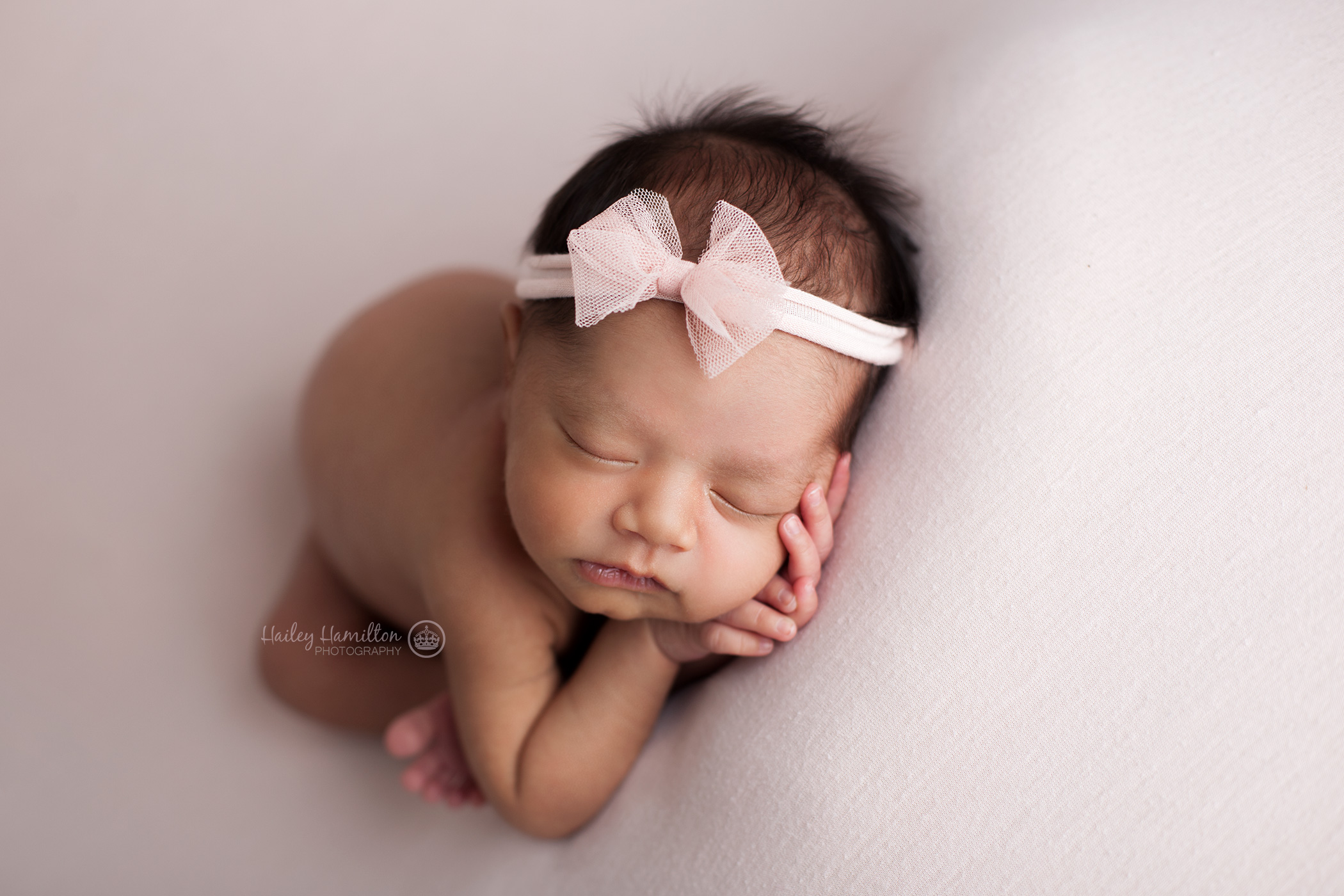 Sleepy newborn baby photography pose