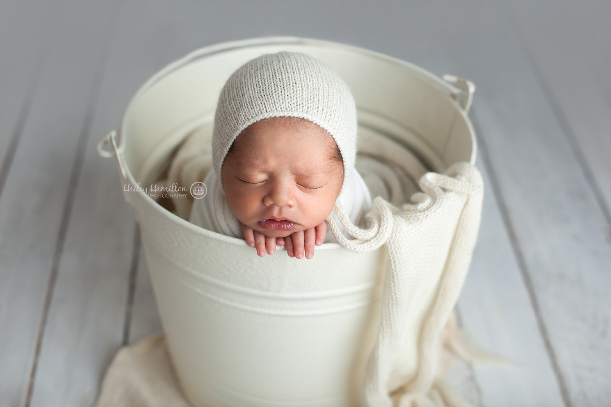Bucket prop newborn pose photo
