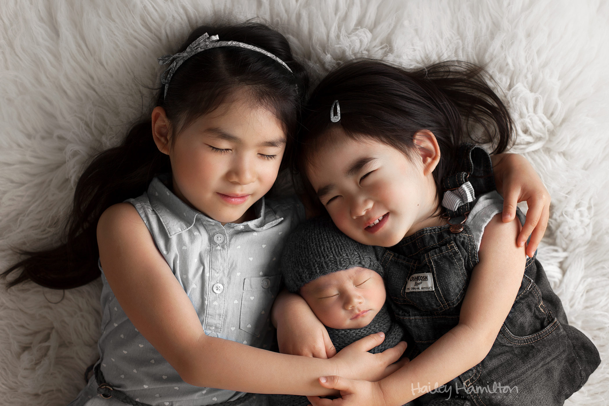 Sisters Posed with Newborn Baby Brother