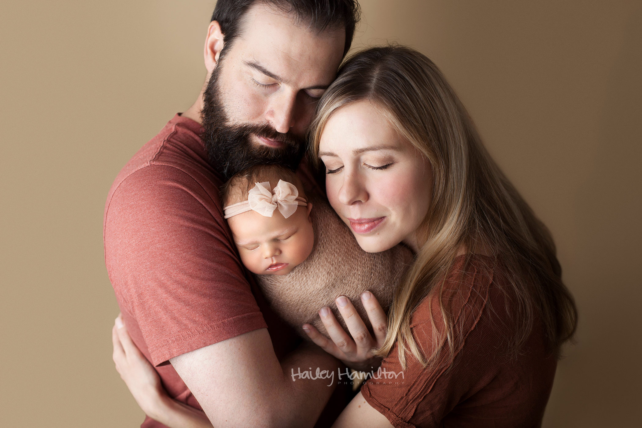 New Parents With Newborn Baby Girl in Fall Tones