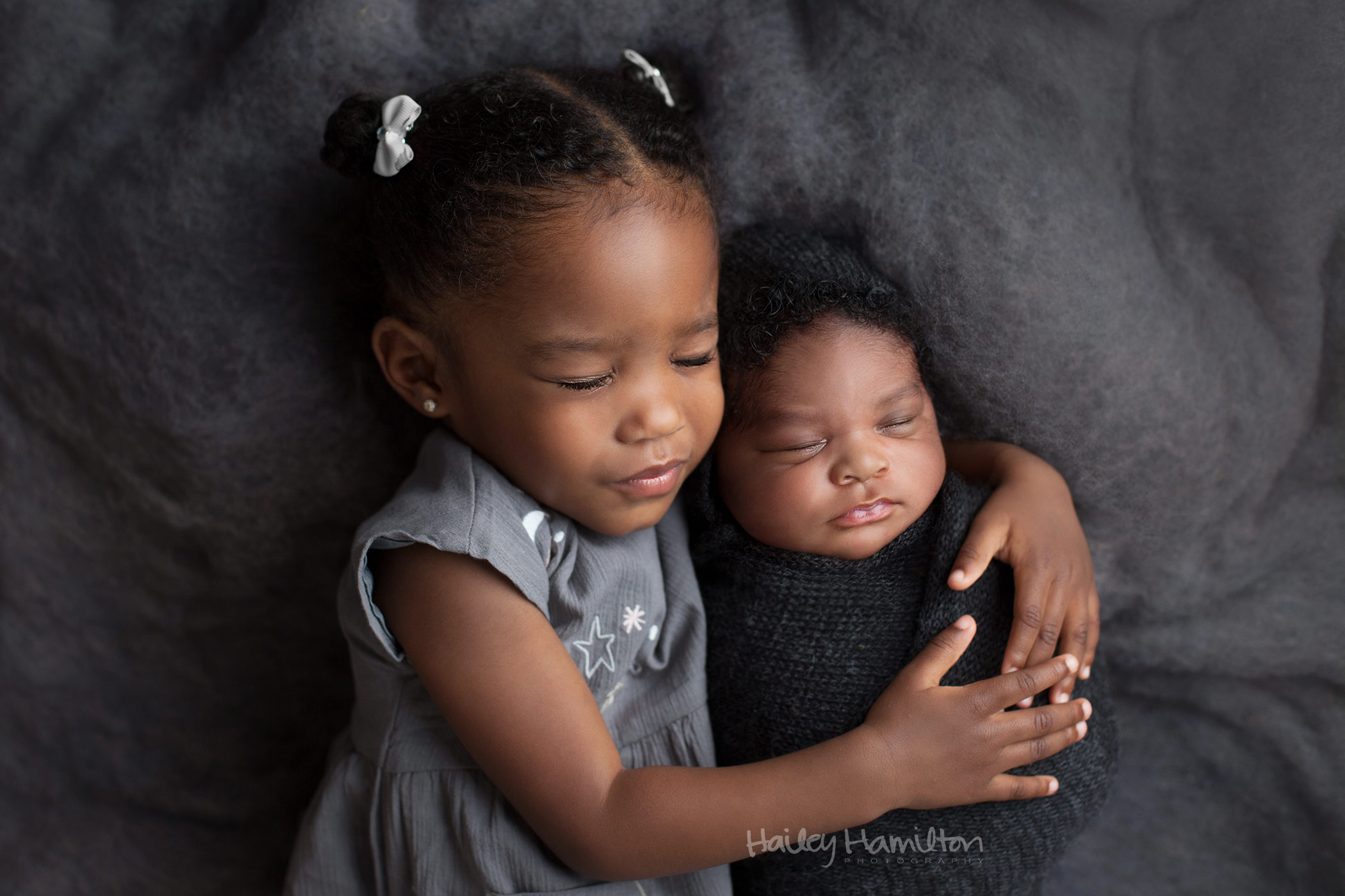 Neutral Newborn Baby Photography with siblings in Calgary
