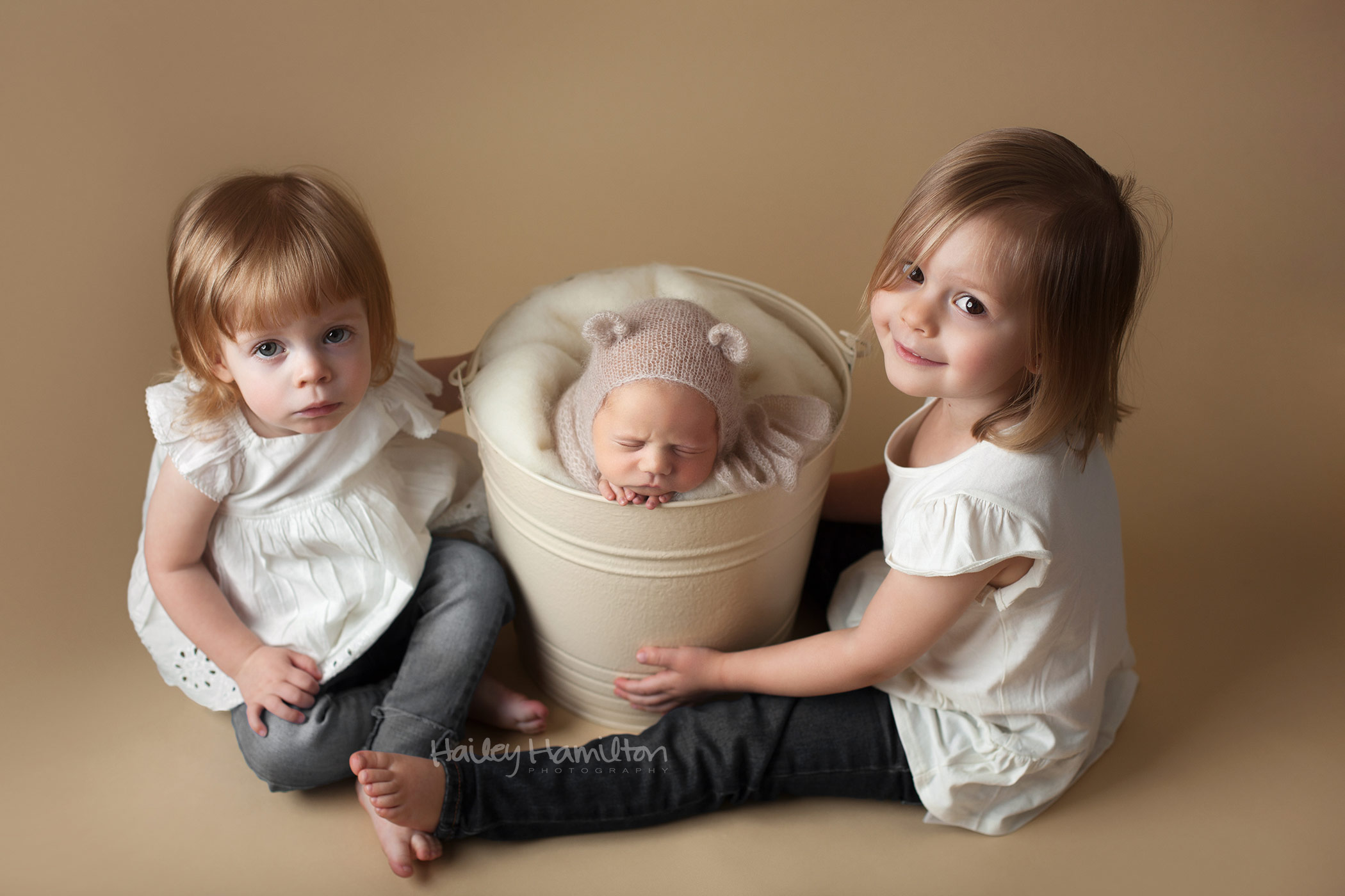 Sisiters with their Newborn Brother in a Bucket
