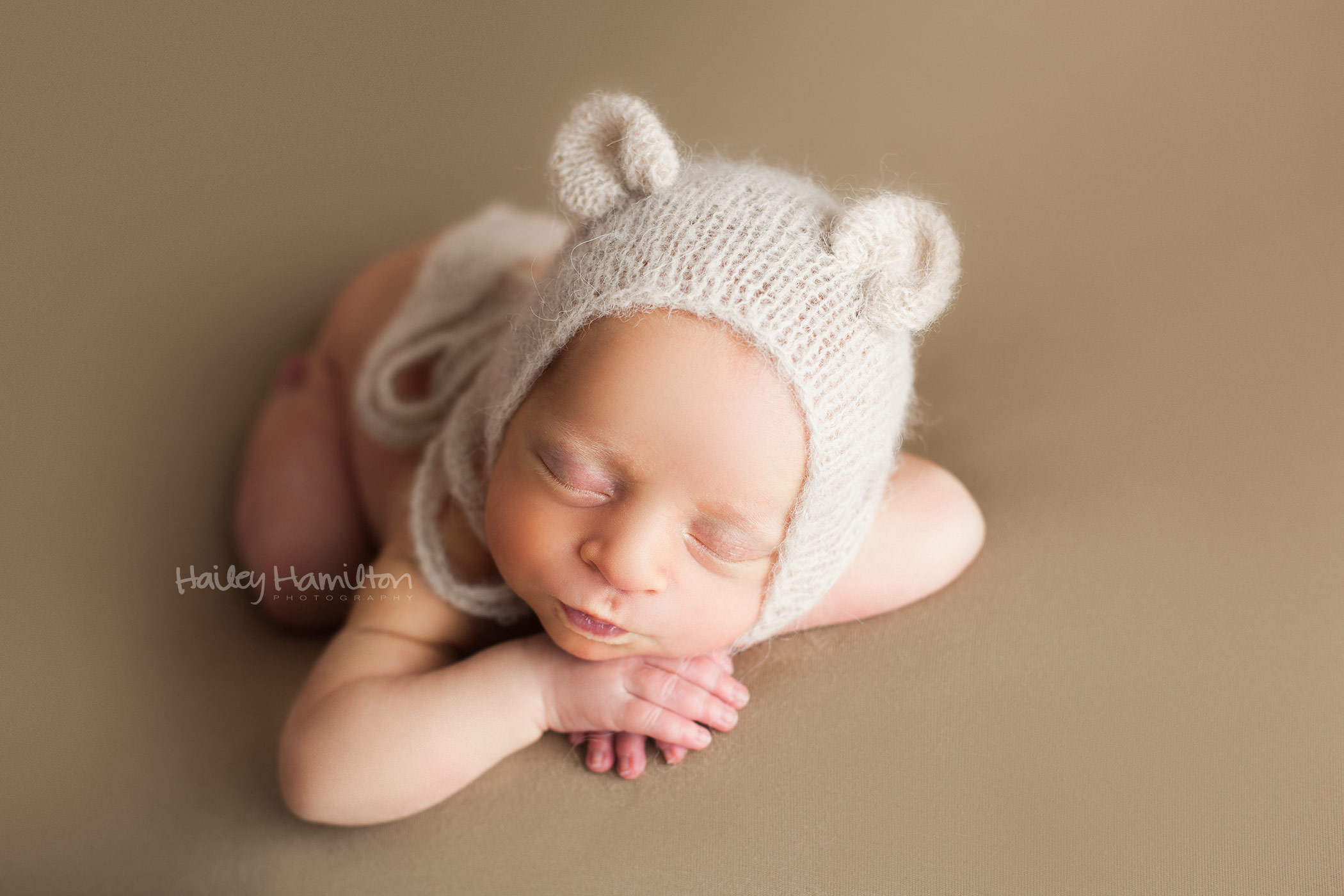 Newborn Boy Wearing Bear Bonnet