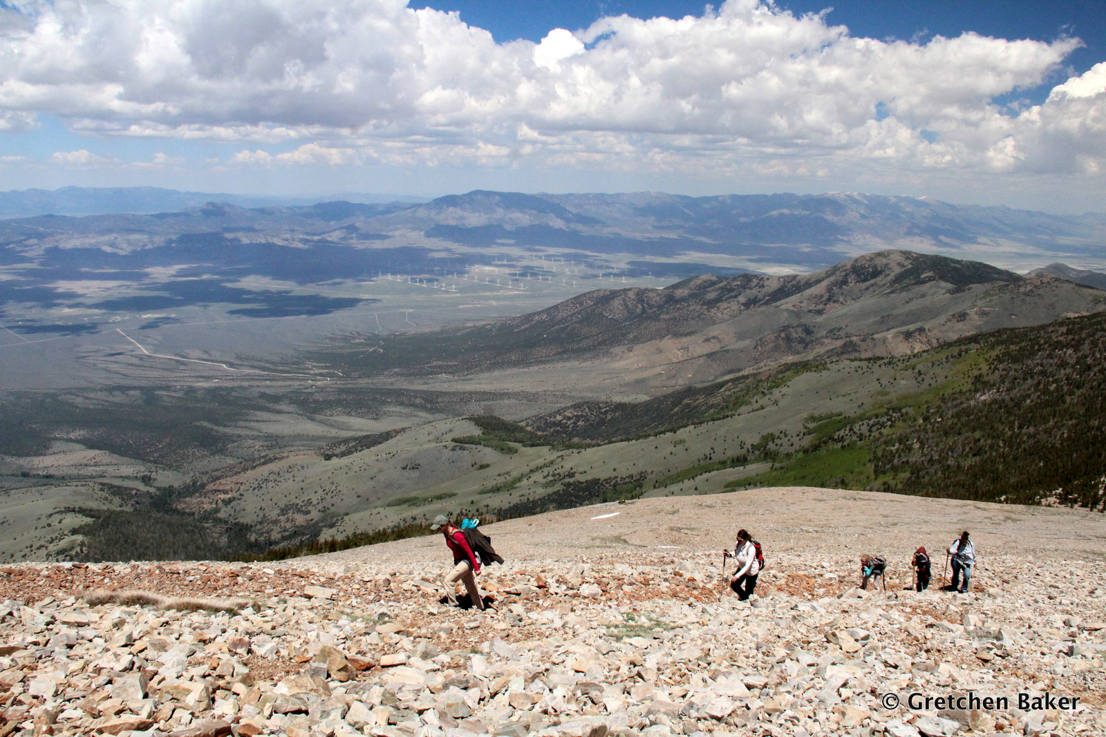 Gretchen Baker_hiking up Wheeler Peak with windmills and Spring Valley in background.JPG