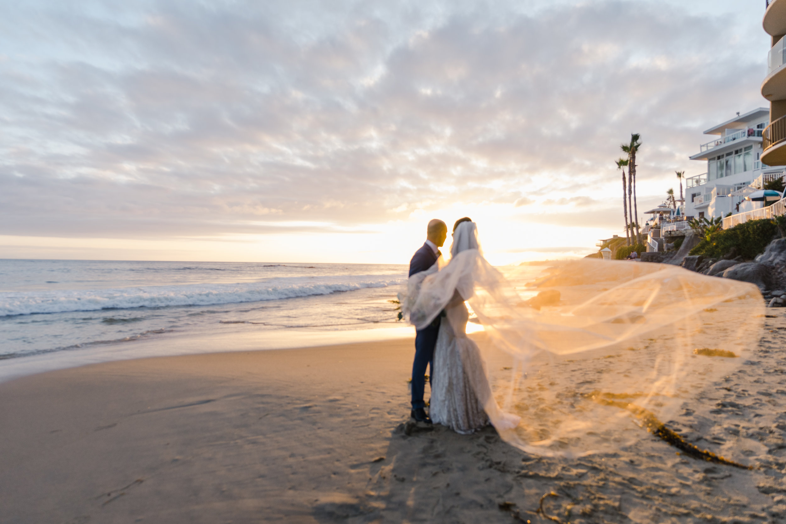 An amazing Laguna Beach sunset to frame this bride and grooms's perfect and blissful wedding day. PC: Jim Kennedy Photography