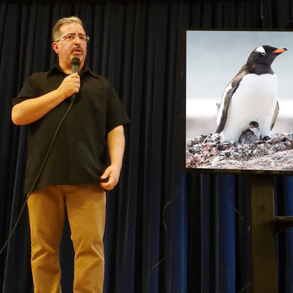 "Photographer and Focus Relief founder Tarik Trad sharing his experiences to an audience at a presentation of  ""The Way South - A Digital Expedition of the Antarctic Peninsula."""