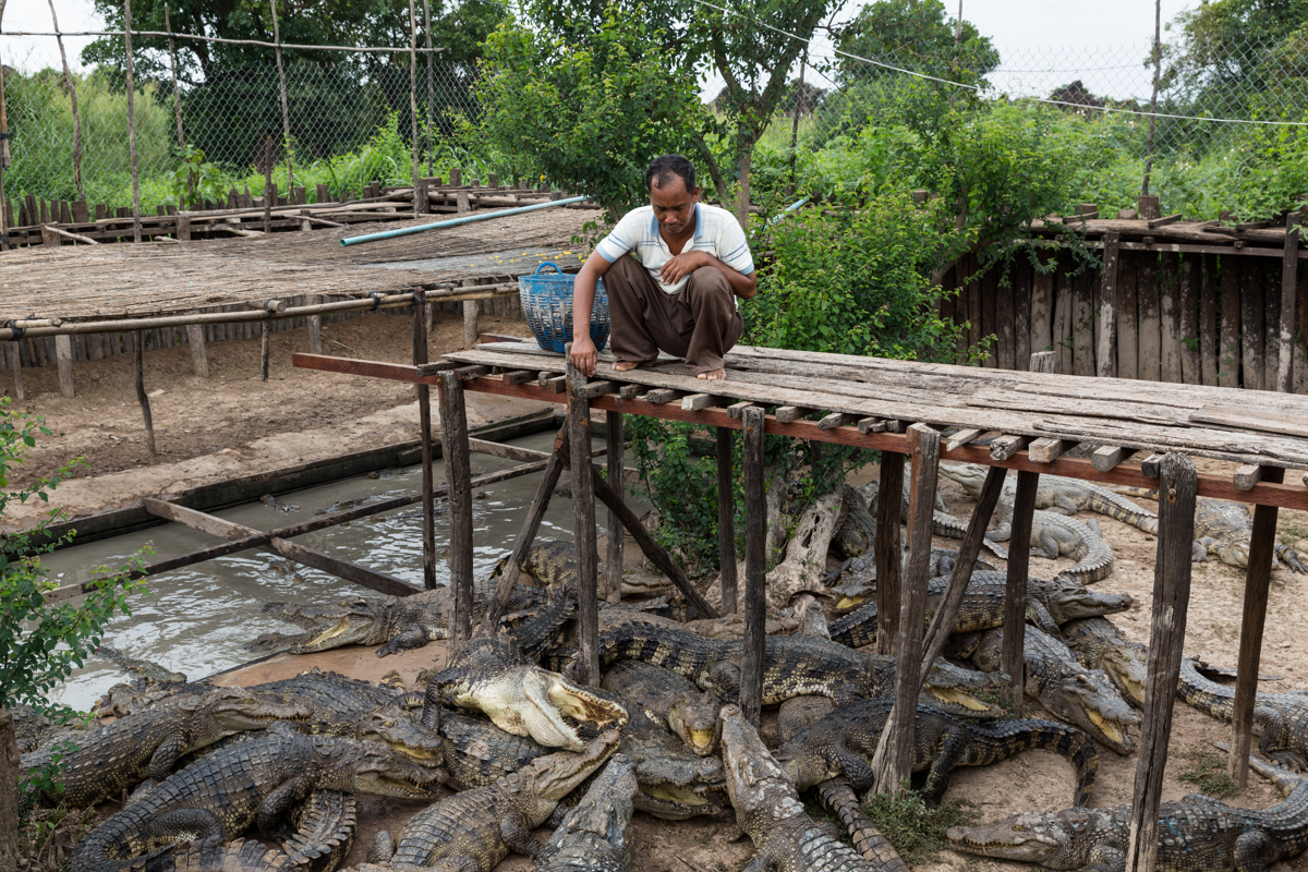 March 29, 2017 - Prek Tol, Cambodia. Ly Heng (46), owns a small floating general store and a crocodile farm. He often loans goods to families who cannot afford to pay, complaining that the people in his village are getting more indebted. © Nicolas Axelrod / Ruom