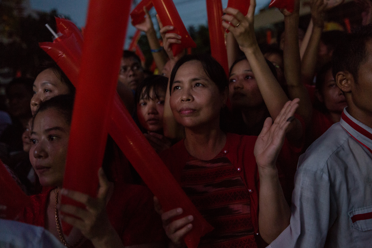 November 9, 2015 - Yangon, Myanmar. Supporters of Aung San Suu Kyi's National League of Democracy (NLD) wait outside the party headquarters as a large TV screen shows the results announced by the Union Election Commission. The NLD won Myanmar's 2015 national elections, yet Aung San Suu Kyi's party and leadership has shown little interest to appease religious tensions in Myanmar. Only a year after the elections Myanmar's army started a genocide against Burmese Rohingya Muslims living in provinces near the Bangladeshi border leaving thousands dead and some 700,000 displaced. © Nicolas Axelrod / Ruom