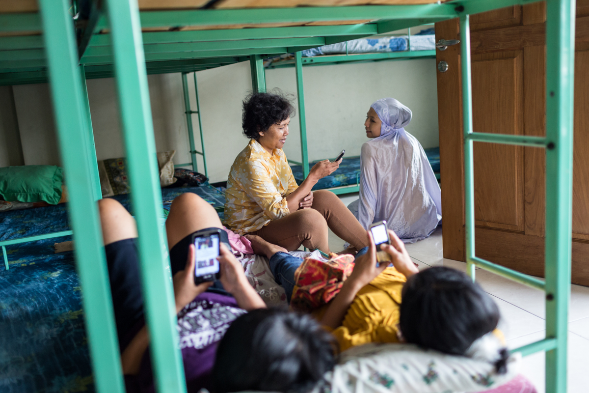 June 06, 2014 - Kendal. Aspiring domestic workers relax in their room of a training centre. © Nicolas Axelrod / Ruom