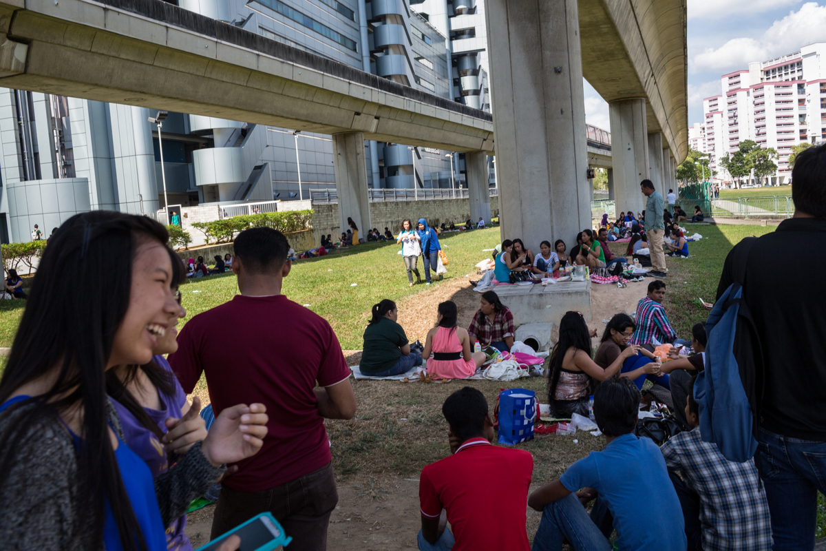 March 23, 2014 - Singapore. Domestic workers and other migrants meet up at Payar Labar to pic-nic and catch up with friends on their day off. Though Sundays are meant to be days off for domestic migrant workers, employers can request that they work 7 days a week. © Nicolas Axelrod / Ruom