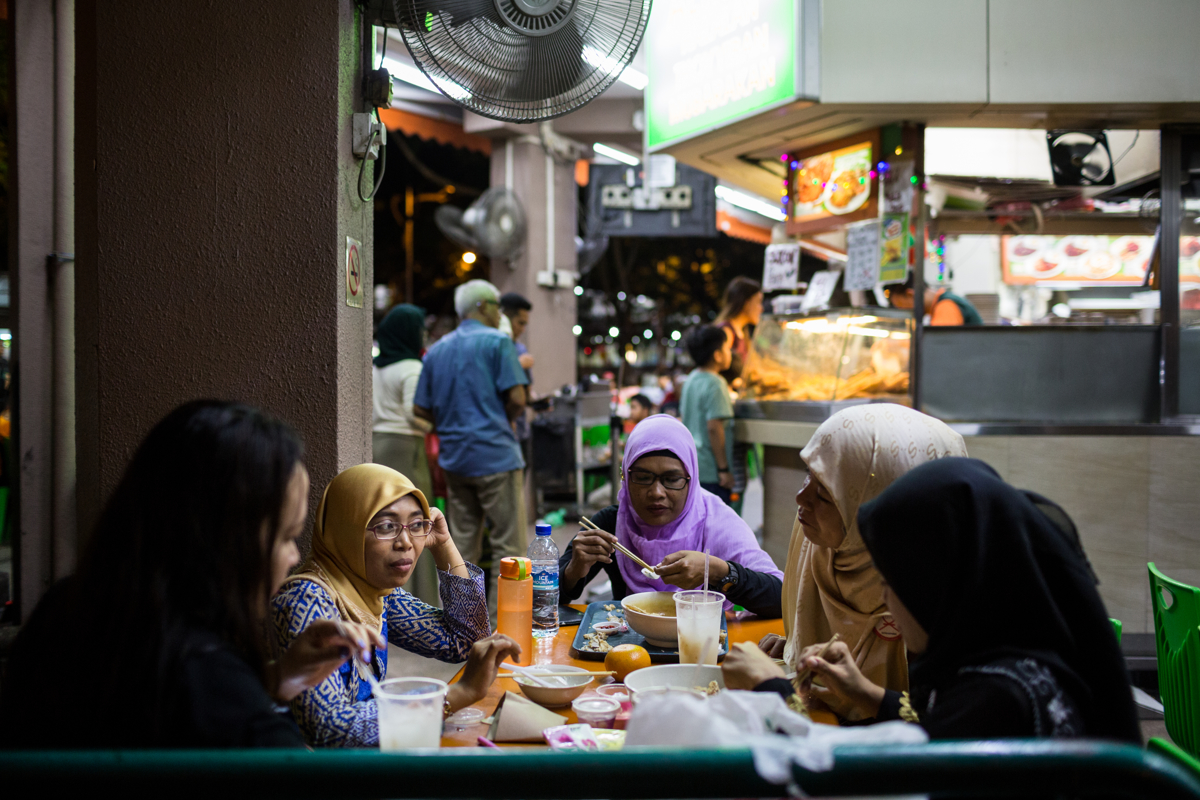 Jan 15, 2017 - Singapore. Anandha has dinner with friends. Anandha prepares to leave Singapore after more than seven years in the island nation. © Nicolas Axelrod / Ruom