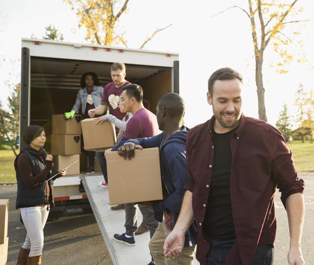 volunteers-loading-cardboard-boxes-onto-truck-208322133 copy.jpg