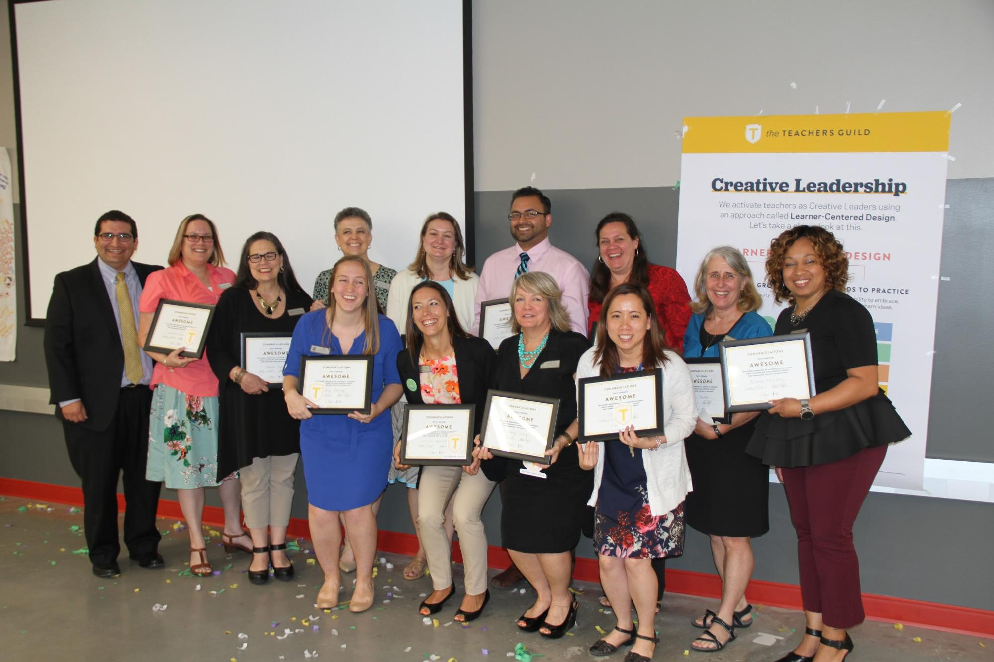 Gwinnett County Public School teachers proudly display their Certificates of Awesome after presenting ideas at their Impact Showcase.
