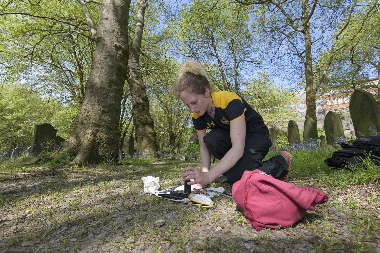 Vicki Pattison Willits undertaking field research at study site in urban cemetery, Birmingham.