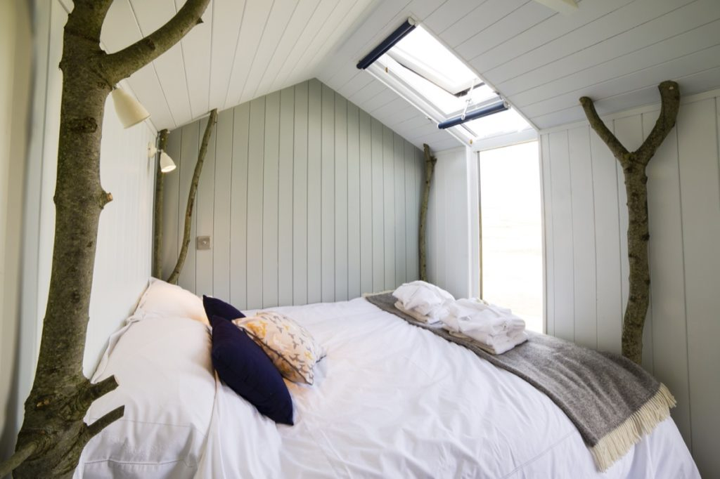 bed-with-floor-to-roof-window-lights-on.jpg