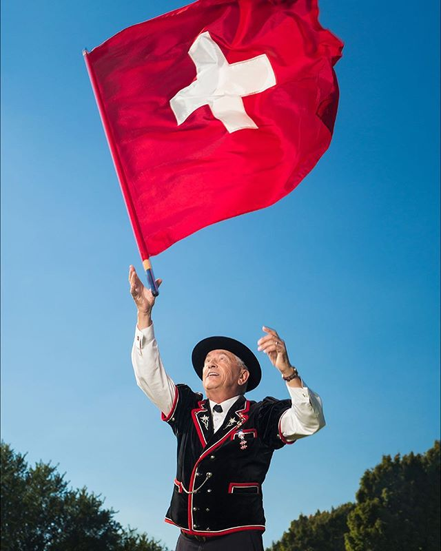 Hometown series again!  #Fahnenschwingen (literal translation: flag swinging) is one of the oldest national sports in #Switzerland but is today mostly seen at festivals.  There are more than 50 moves divided into five categories for judging, all to be mastered with both right and left hands.  Steve has practiced this #Swiss art for decades in my small hometown, and helps to introduce a new generation of flag swingers.  #seattlephotographer #editorialphotographer #paulcbuff #portraitperfection #onlocation #environmentalportrait #agameoftones #pursuitofportraits #personalproject #portrait #makeportraits #lucienography