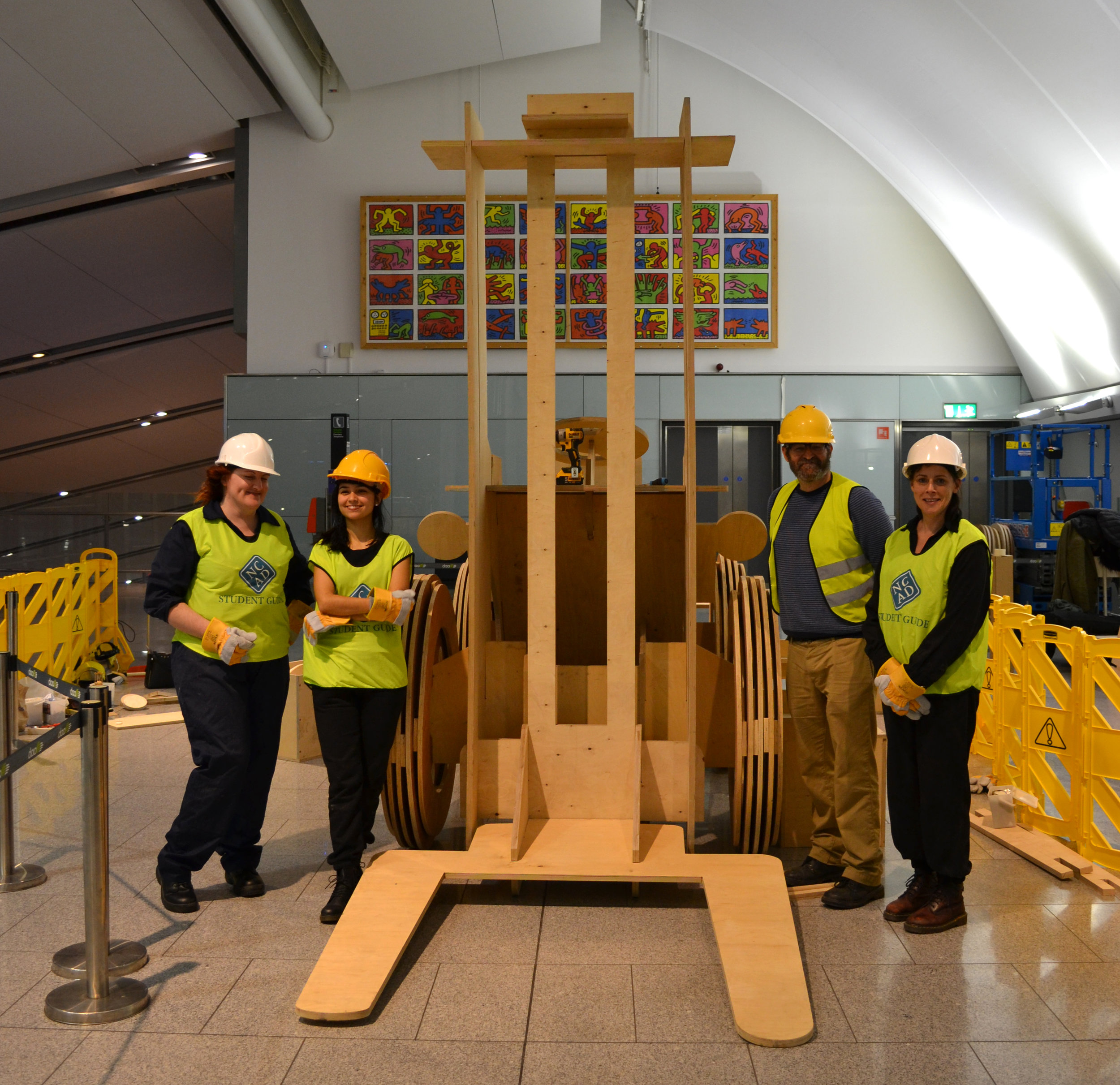 Teamwork - Philip Napier and NCAD Fine Art students construct one of two forklifts at Terminal 2 (airside)