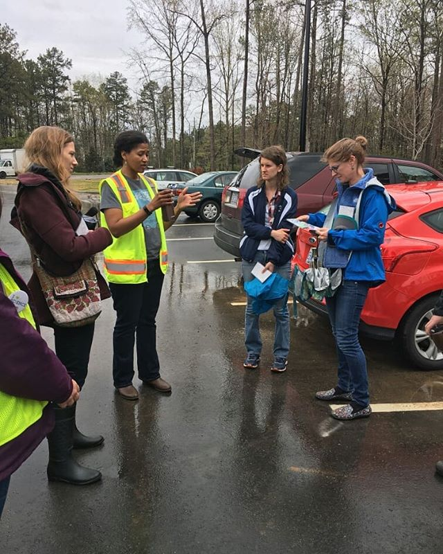 Our Landfills & Lattes field trip started out rainy, but the sun came out a bit! Pictured: the group learns from CAFN Food Recovery Circle member and Wake County Solid Waste Outreach Manager Bianca Howard about Wake's compost program; the group before loading onto the tour bus; gas valve to capture and manage the gas that results from landfilled trash and organic waste; the edge of the liner.