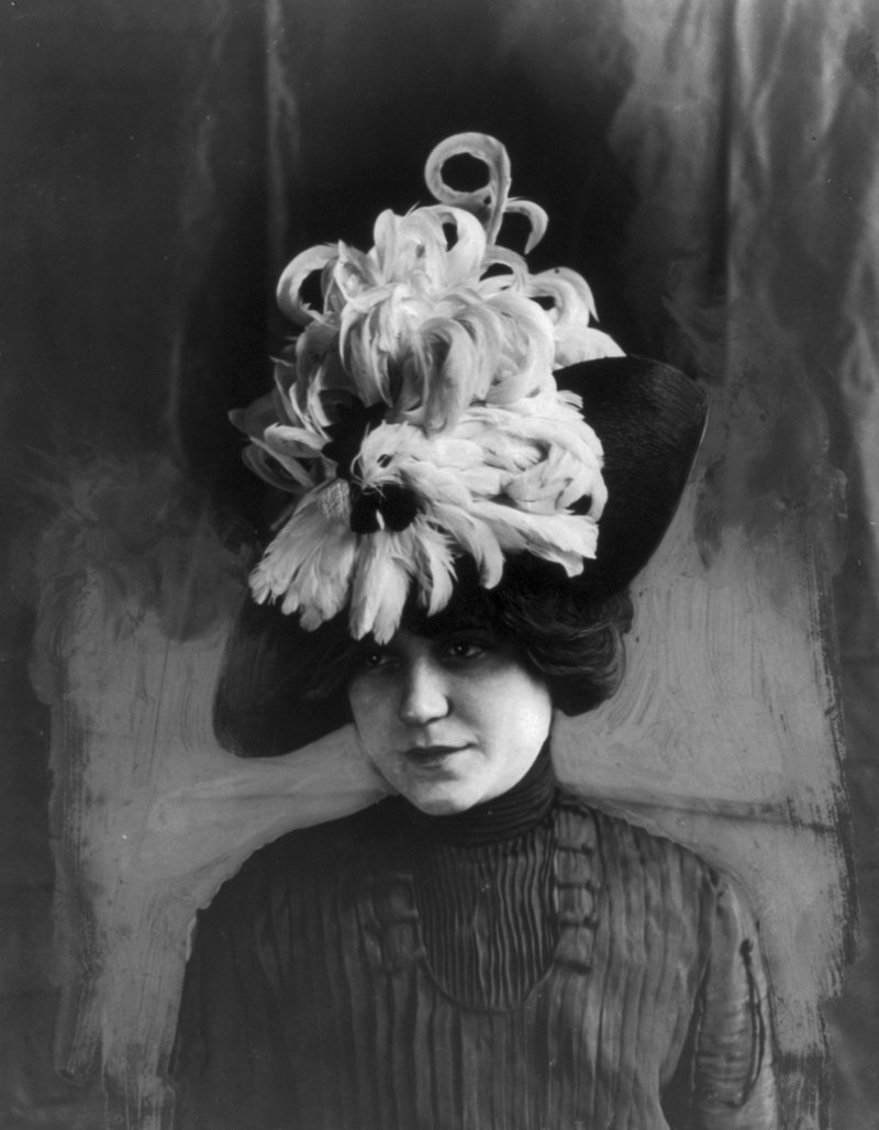 Woman wearing a hat made of bird feathers, circa 1912.   Library of Congress
