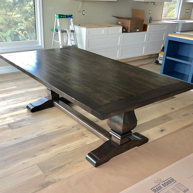 We stripped and bleached this large alder table. Once all the color was removed, we stained with this rich beautiful color and low sheen lacquer finish.