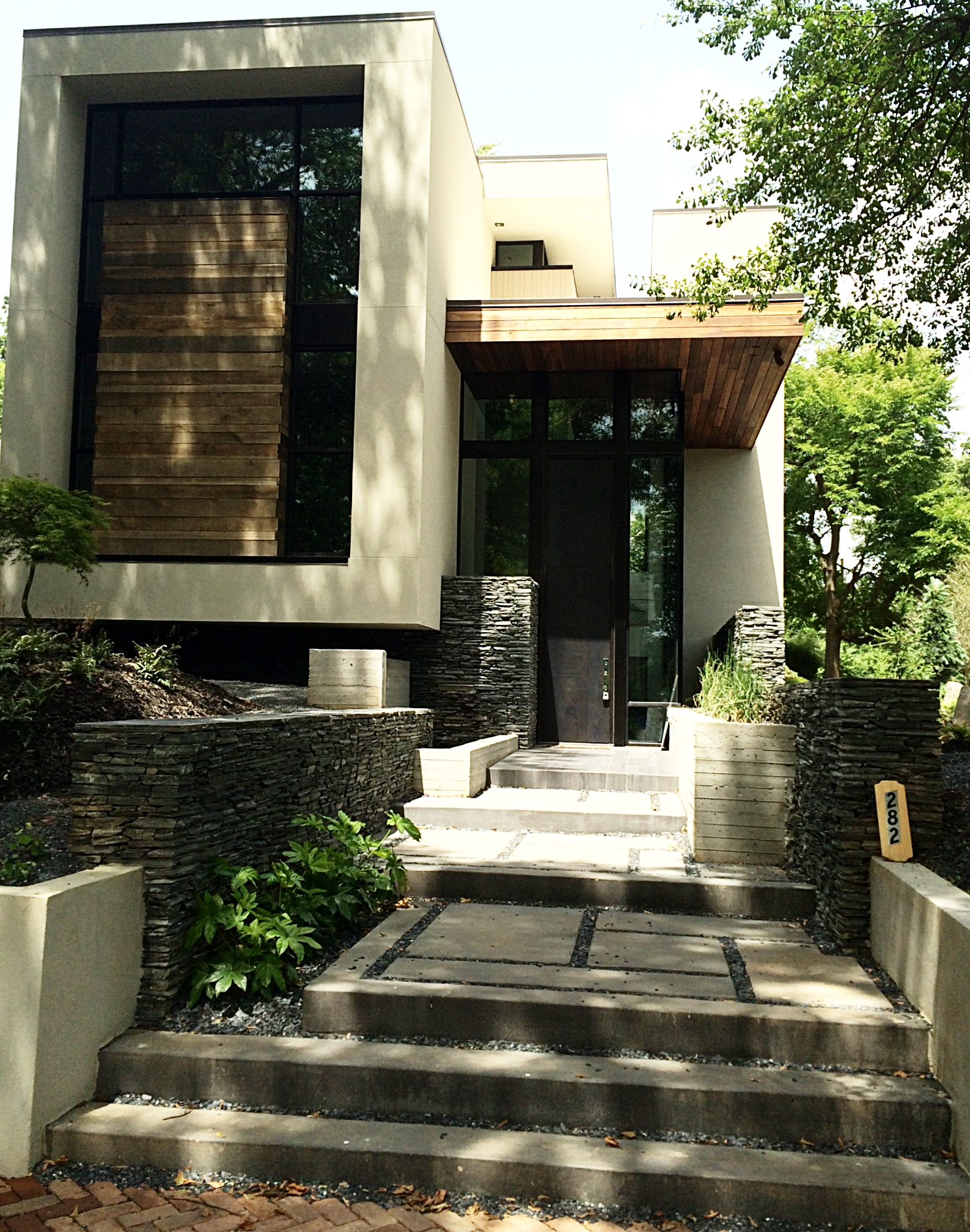 West Architecture Eutree Forest Free white oak outdoor siding and thermo poplar decking
