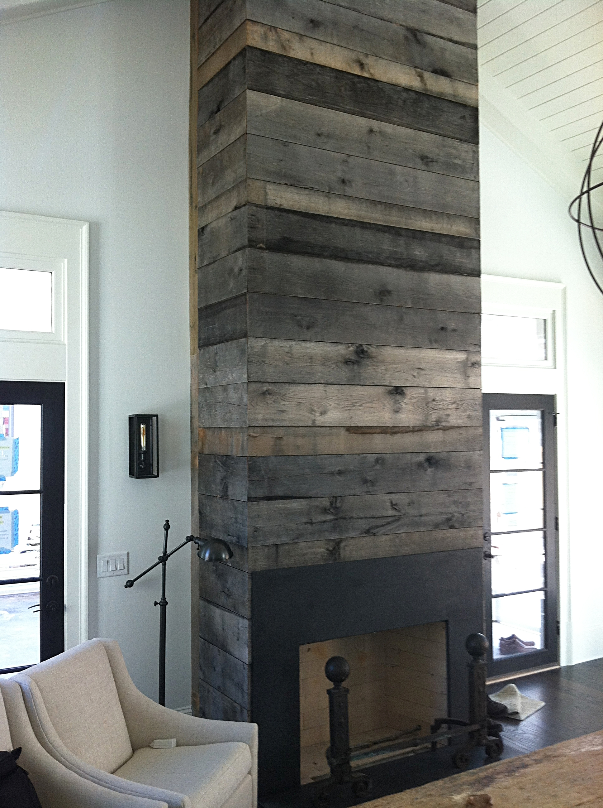 Heirloom Design Build Eutree Forest Free naturally weathered white oak wood paneling feature accent wall fireplace