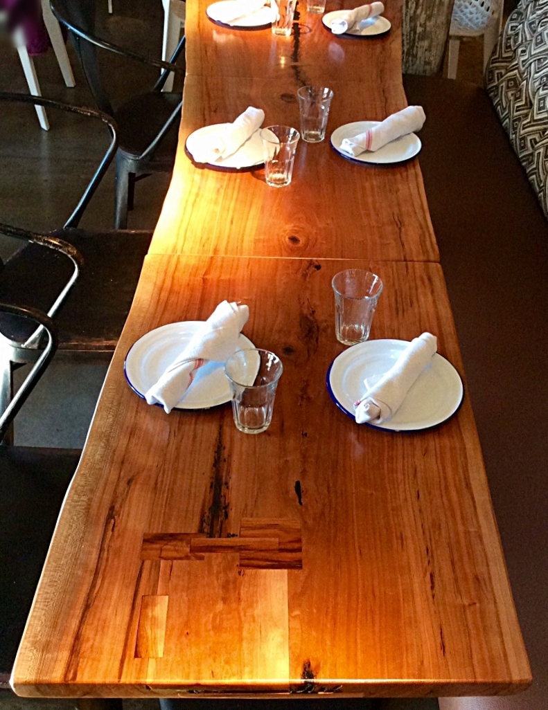 Made KC Cherry and poplar wood slabs tables white oak wood wall paneling feature accent walls