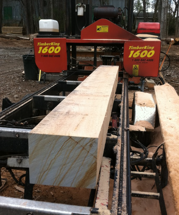 """After the logs were canted, or """"squared off"""", they were ready to be sawn into planks."""