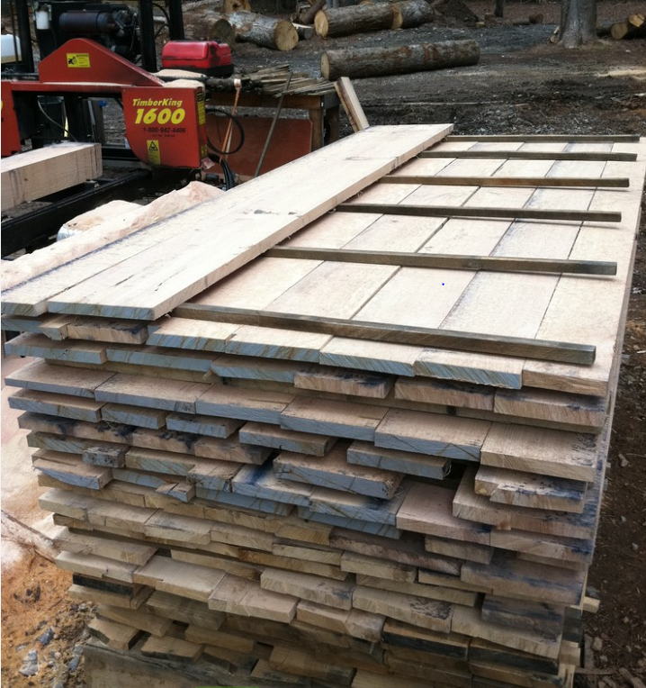 """The rough lumber is stacked with """"stickers"""" between each layer. The stickers create spacing which permits airflow between the lumber and allows it to dry once inside the kiln."""