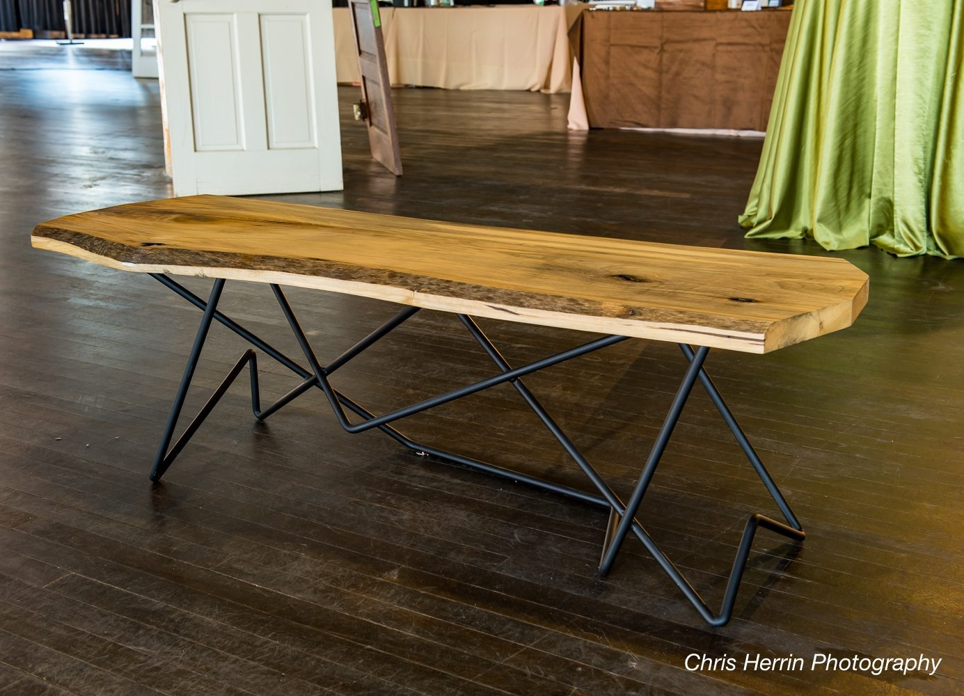 Phil Proctor, a sculptor and Art on the Atlanta BeltLine artist, fabricated this table from one of the poplar slabs. Photo credit: Chris Herrin Photography.