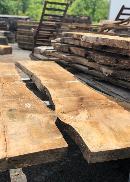 Once all of the logs are cut into slabs on the mill, they're stacked and stickered to air dry in the lumberyard for several months.