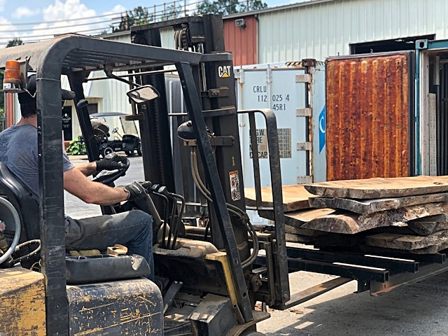 A forklift is used to push the kiln cart with the slabs back into the kilns.