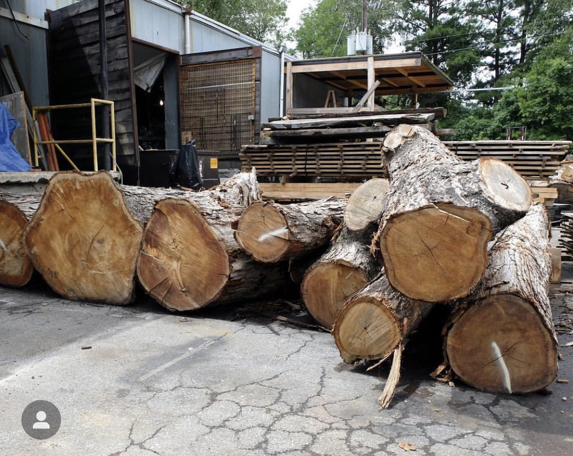 Logs arrive to Eutree's lumberyard to be milled into slabs and dimensional lumber.