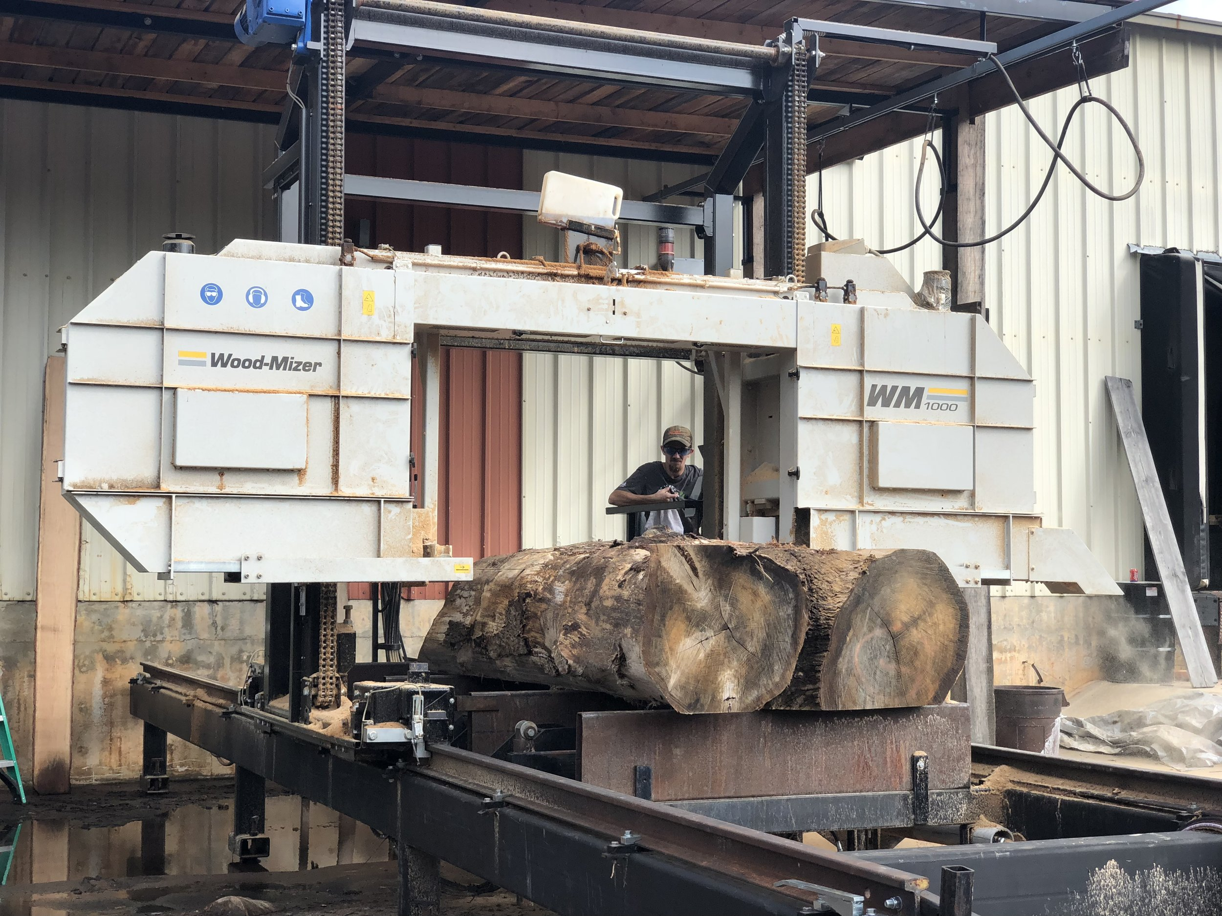 Each log is then milled into live edge slabs and boards for dimensional lumber over the course of two days…