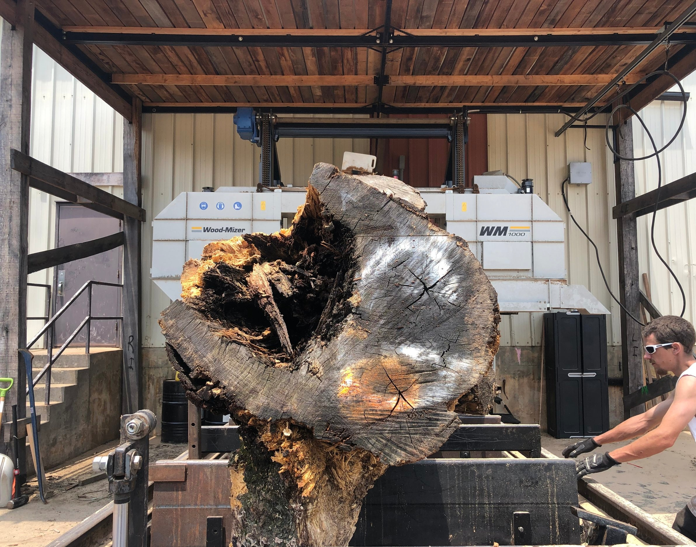 Once the logs are loaded onto the mill, Eutree's Chief Sawyer thoroughly examines the log for any metal, nails or debris that may hinder the milling process.