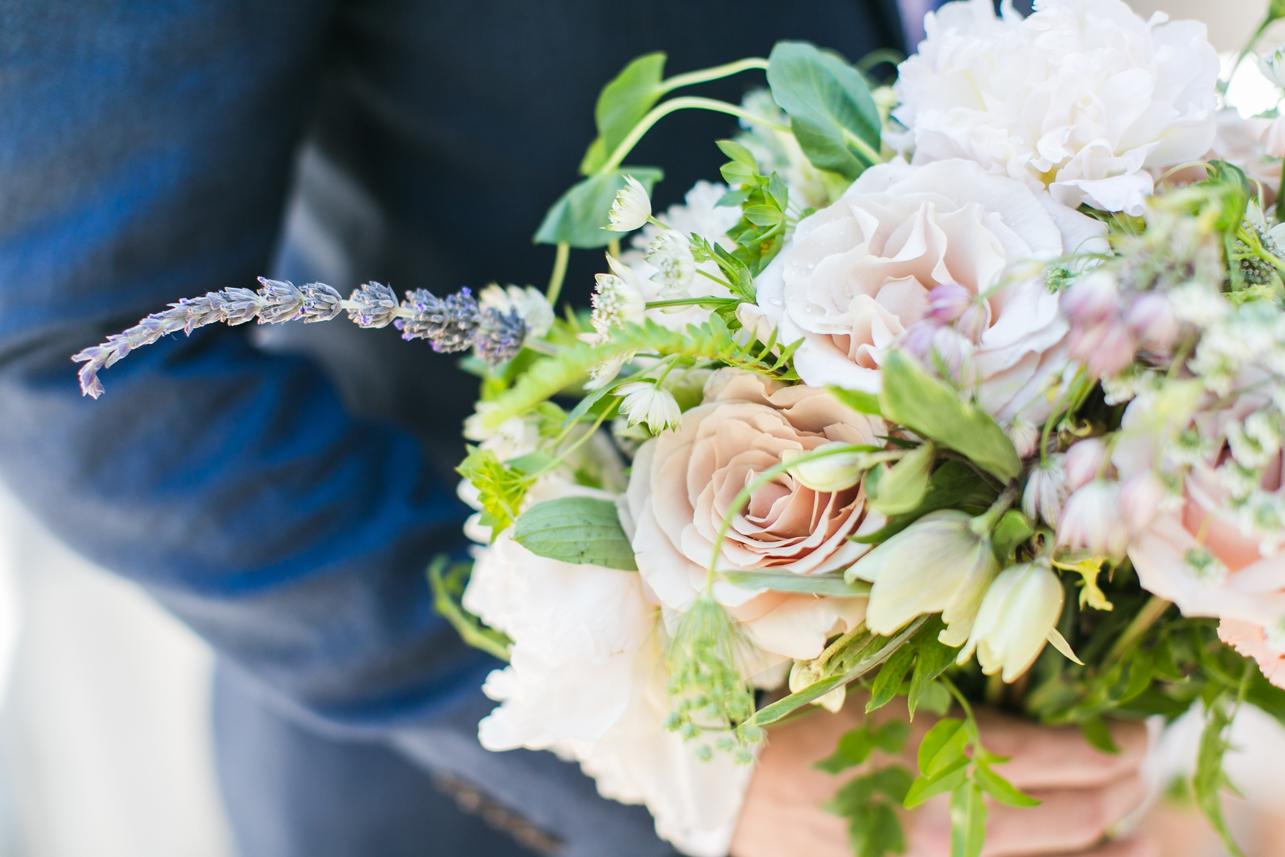 groom-holding-mixed-floral-bridal-bouquet-carrie-vines-photography.jpg