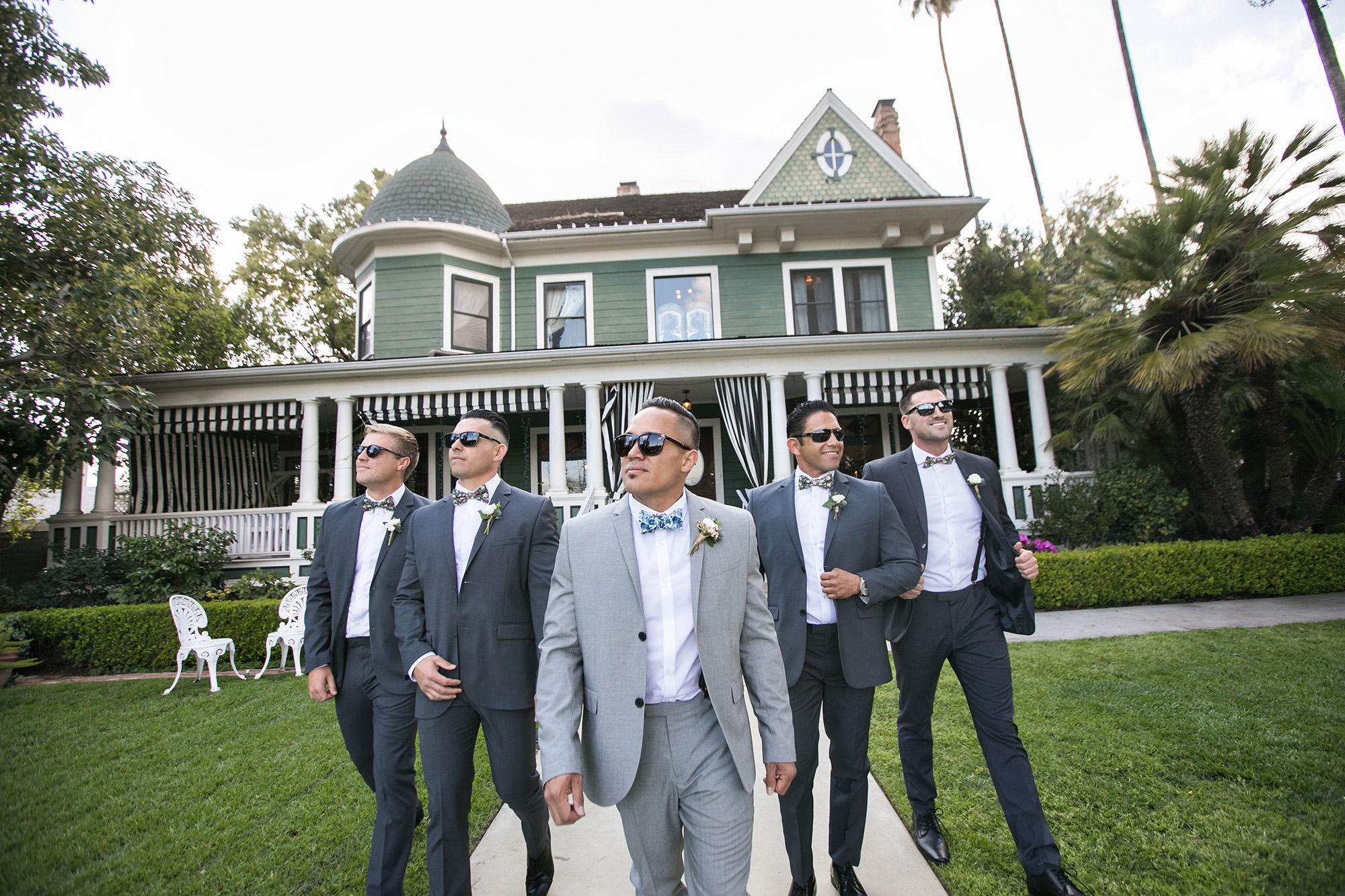 christmas-house-groom-groomsmen-sunglasses-portrait-carrie-vines.jpg