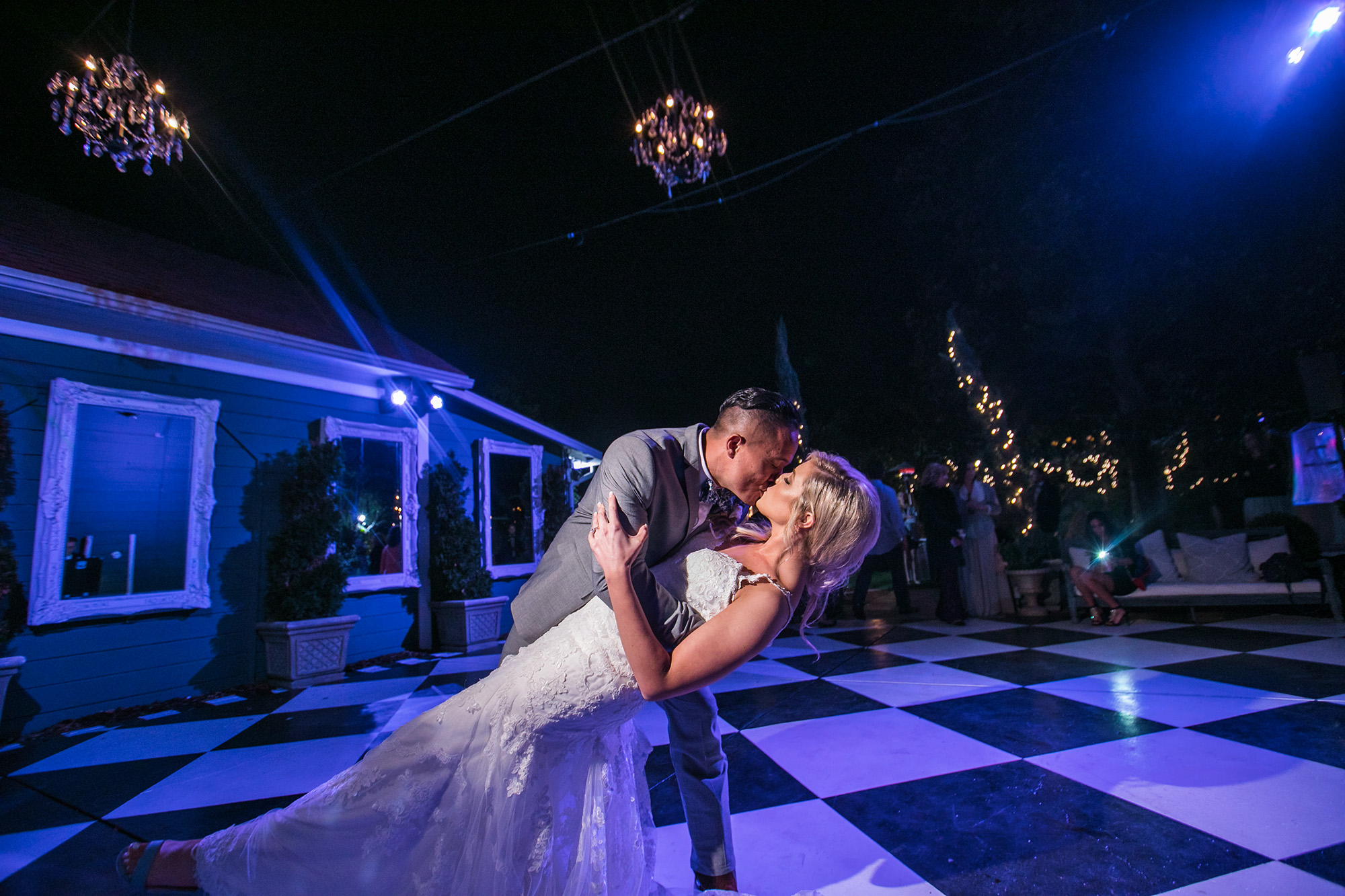 christmas-house-checkered-dance-floor-bride-groom-carrie-vines.jpg