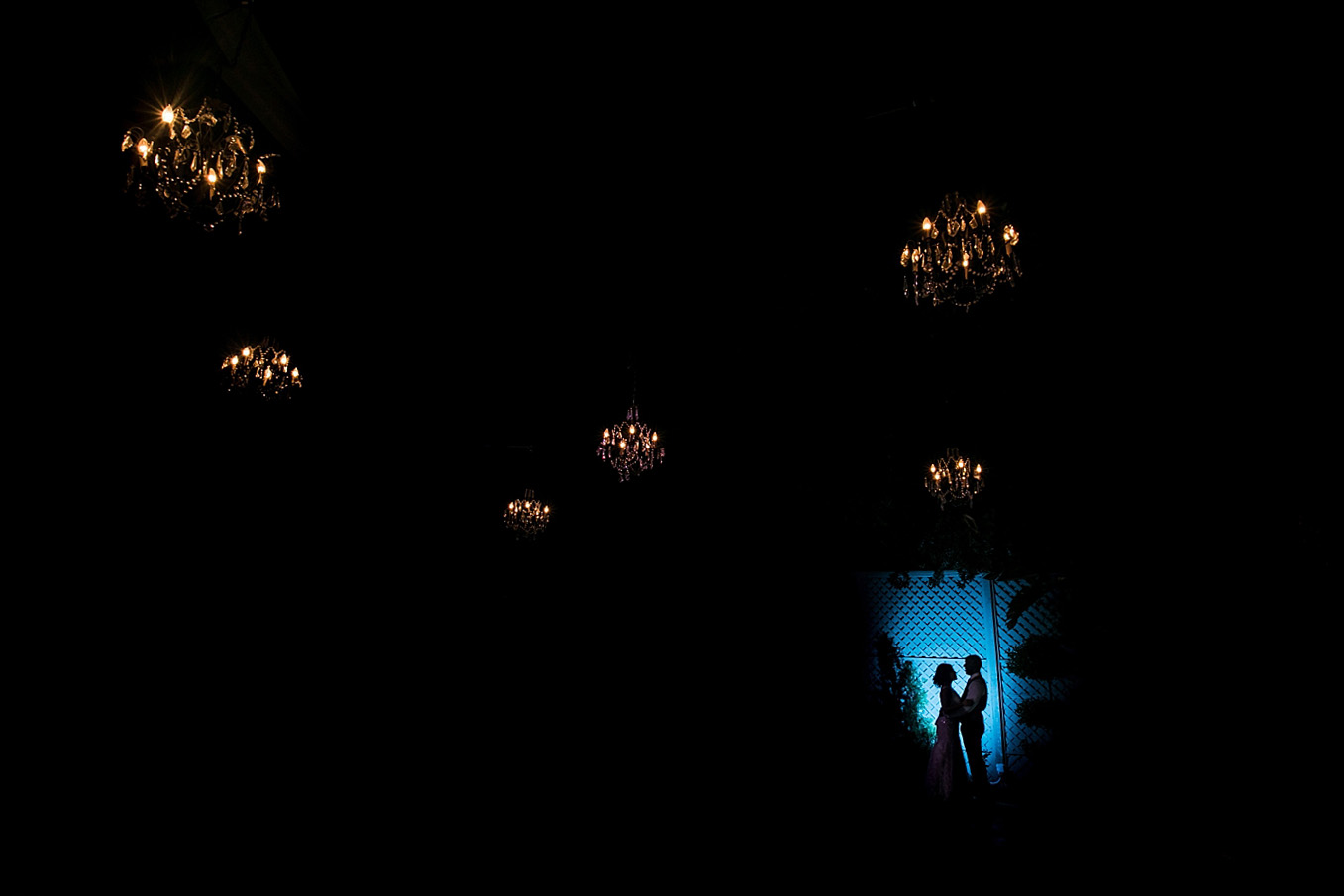 christmas house wedding bride and groom silhouette portrait under chandeliers carrie vines