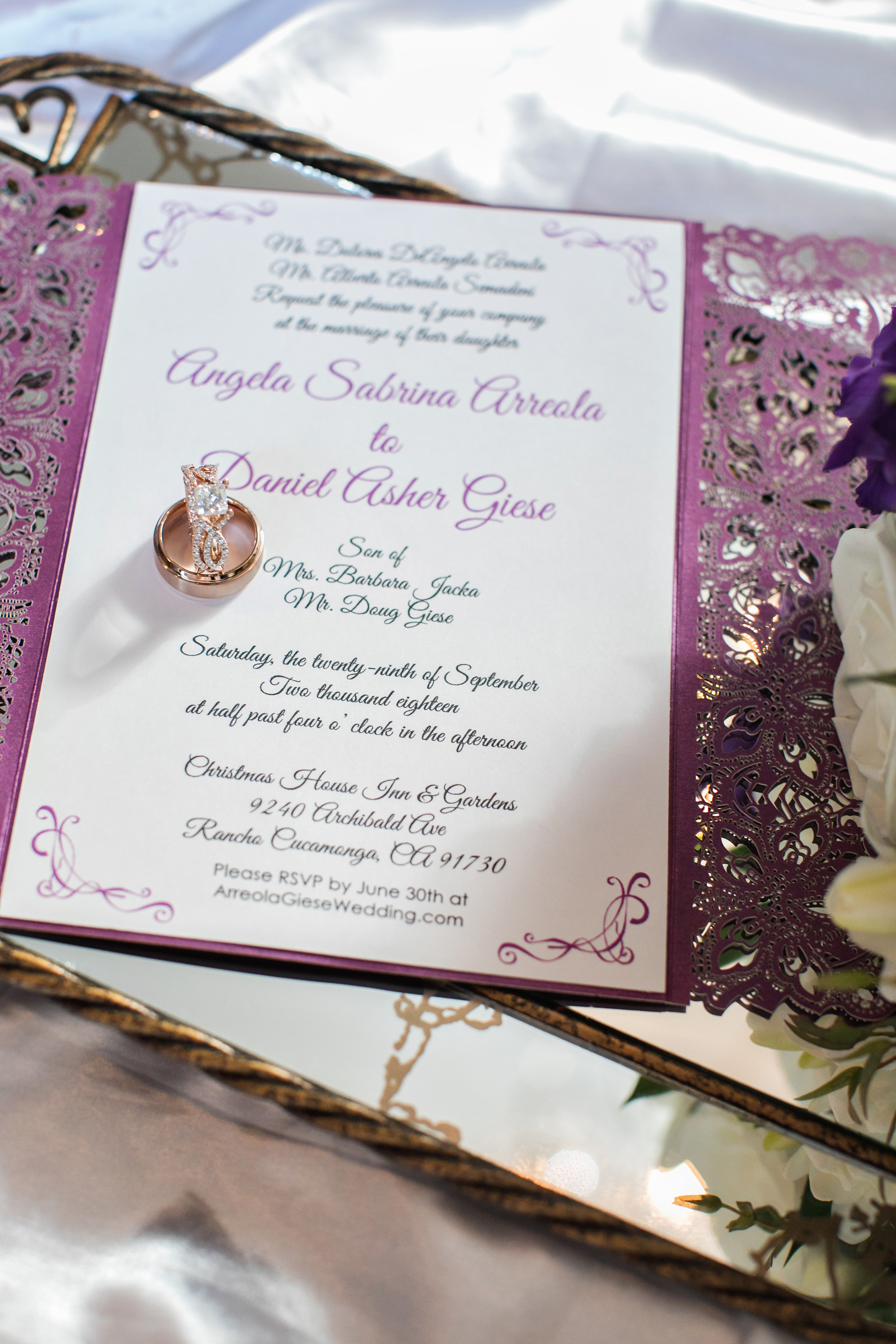christmas house inn and gardens wedding carrie vines photography mauve purple lace wedding invitation with rose gold wedding rings