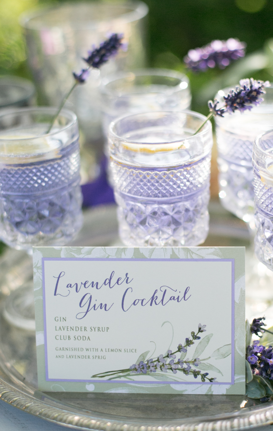 lavender gin cocktail specialty drink at homestead wedding carrie vines photography